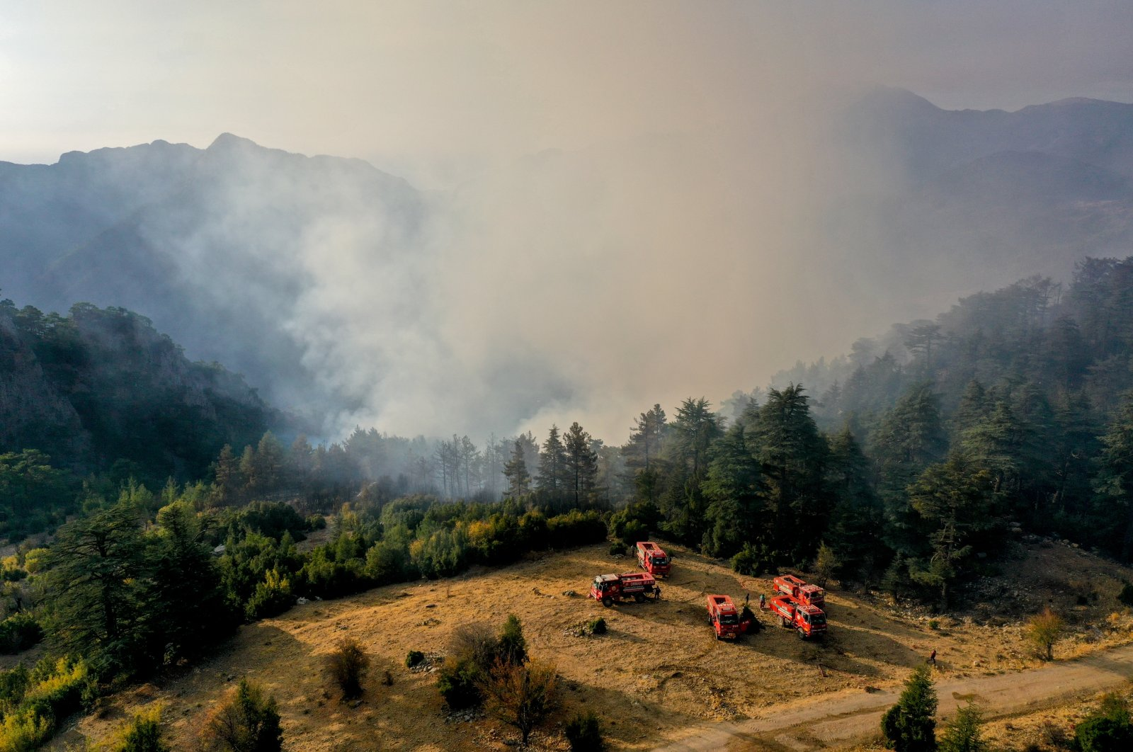 Fire crews continue efforts to put out a wildfire in Kemer district of Antalya, Turkey, Oct. 13, 2021. (AA Photo)