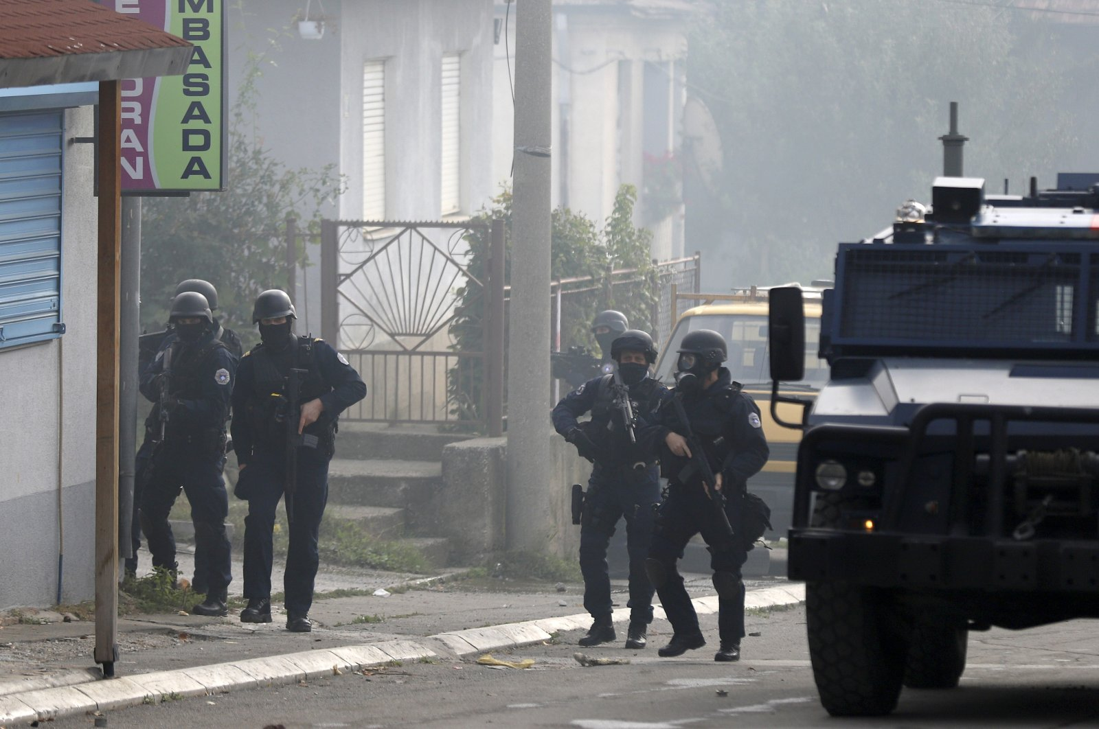 Kosovo police officers guard a street in the northern Serb-dominated part of ethnically divided town of Mitrovica, Kosovo, Oct. 13, 2021. (AP Photo)