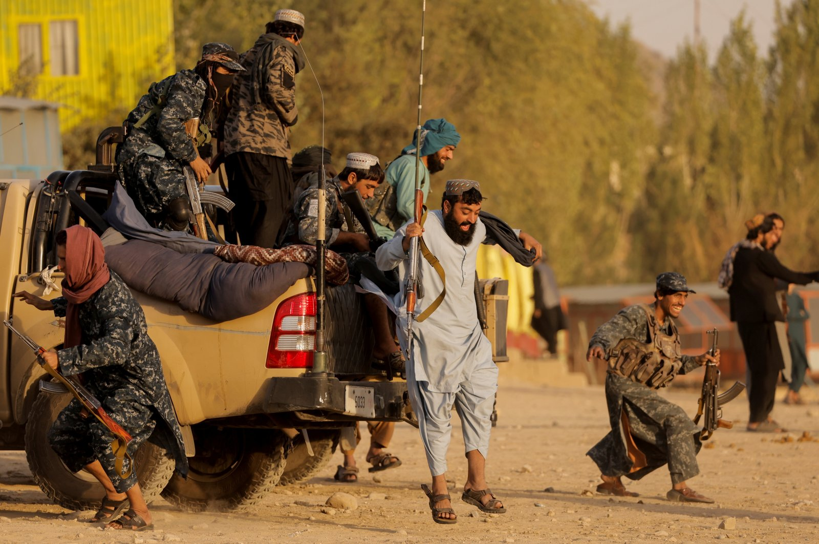 Taliban fighters get out of a vehicle as they take a day off to visit the amusement park at Kabul's Qargha reservoir, at the outskirts of Kabul, Afghanistan, Oct. 8, 2021. (Reuters File Photo)
