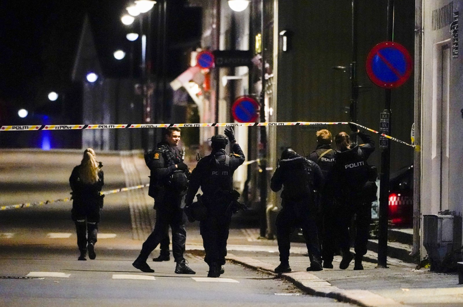 Police stand at the scene after an attack in Kongsberg, Norway, Oct. 13, 2021. (AP Photo)