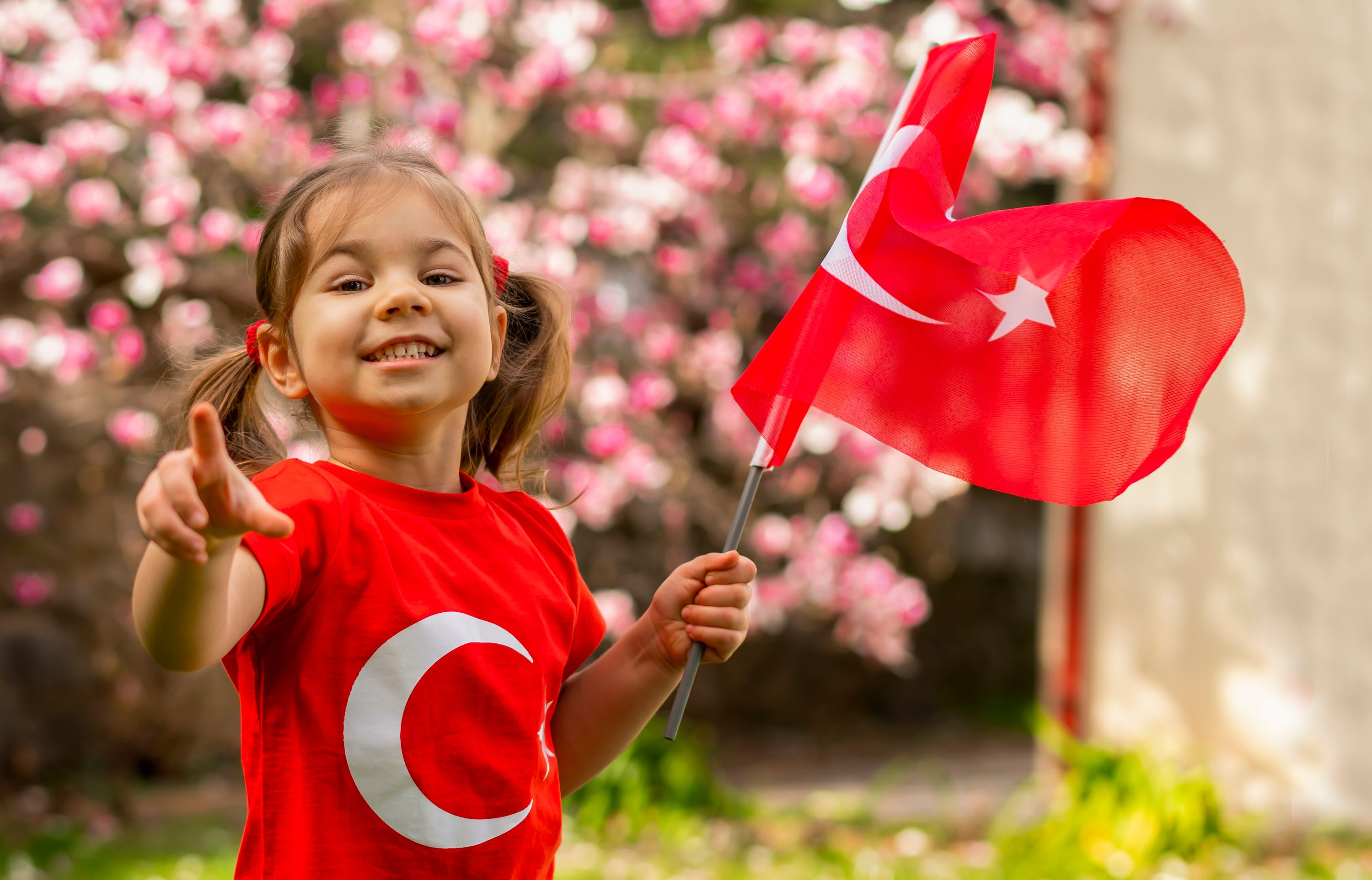 Toddler holds the Turkish flag in their hand. (Shutterstock Photo)