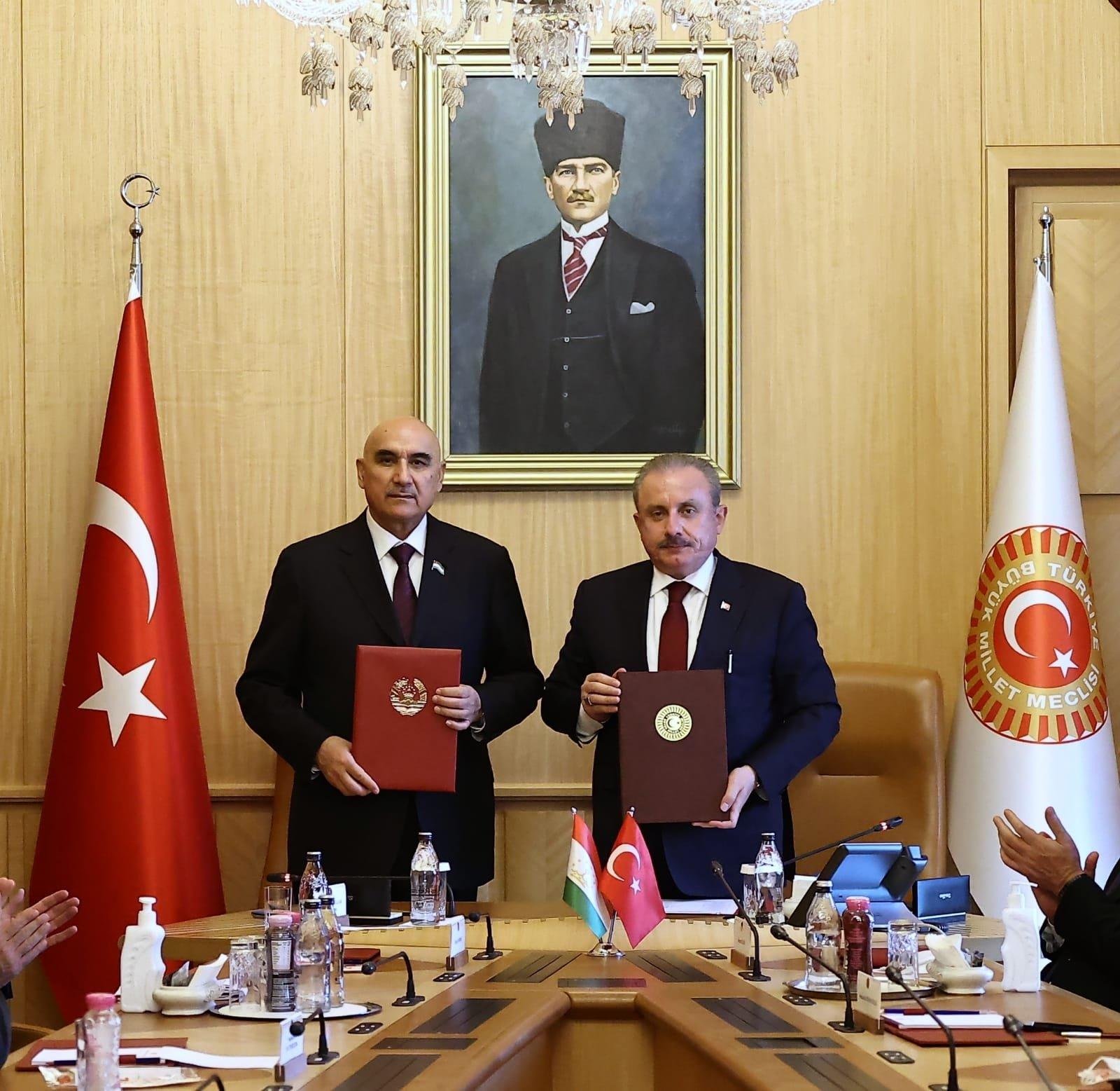 Parliament Speaker Mustafa Şentop (R), Tajik counterpart Mahmadtoir Zokirzoda pose after signing the interparliamentary cooperation protocol in Ankara, Turkey, Oct. 13, 2021. (AA Photo)