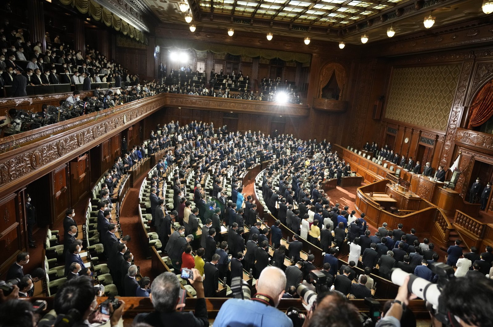 Lawmakers listen to the announcement of the dissolution of the lower house, Oct. 14, 2021, in Tokyo. (AP Photo)