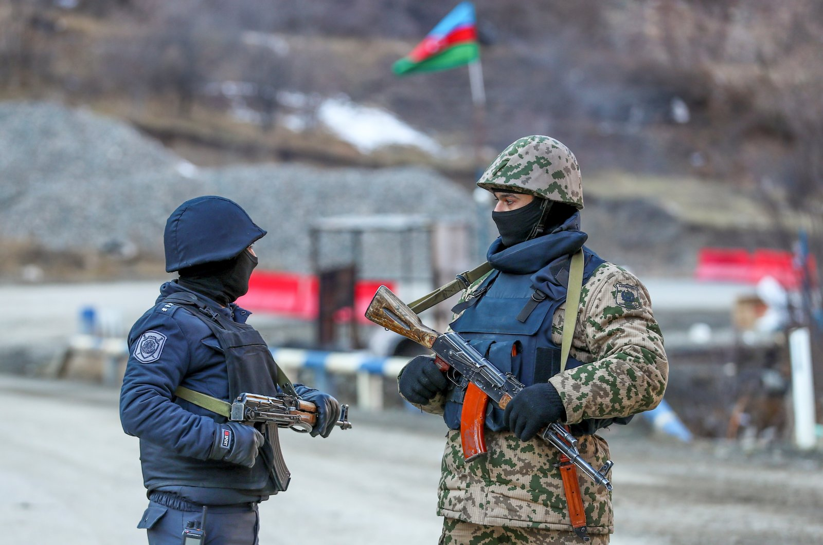 An Azeri soldier and police officer talk as they stand guard at the Kalbajar district, Azerbaijan, Dec. 21, 2020. (Reuters File Photo)