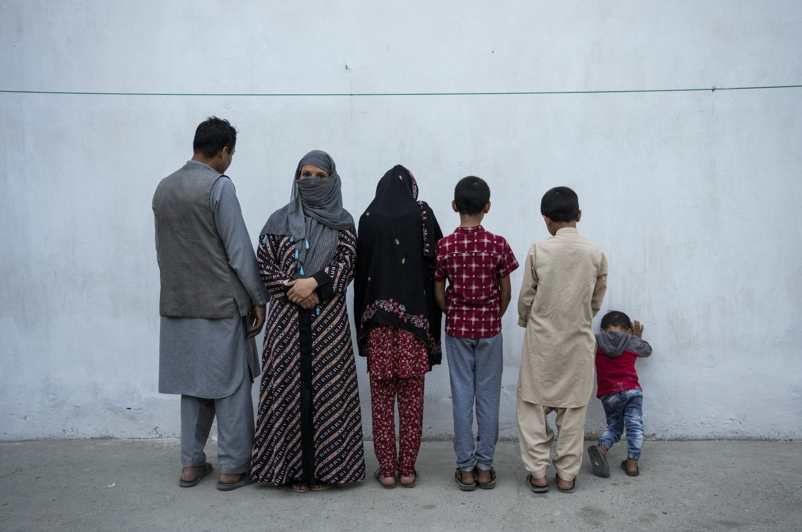 Najia (2nd L) poses with her family in Kabul, Afghanistan, Oct. 1, 2021. (AP Photo)