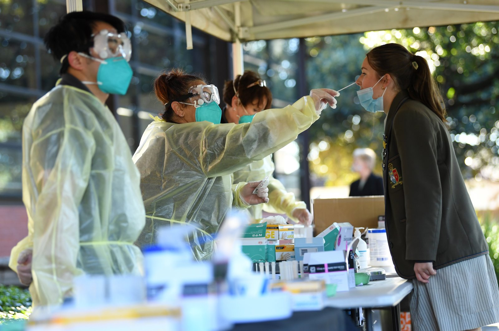A young woman receives a COVID-19 rapid antigen test administer by a TLC Healthcare worker in Brighton, Melbourne, Australia, Oct. 14, 2021. (EPA Photo)