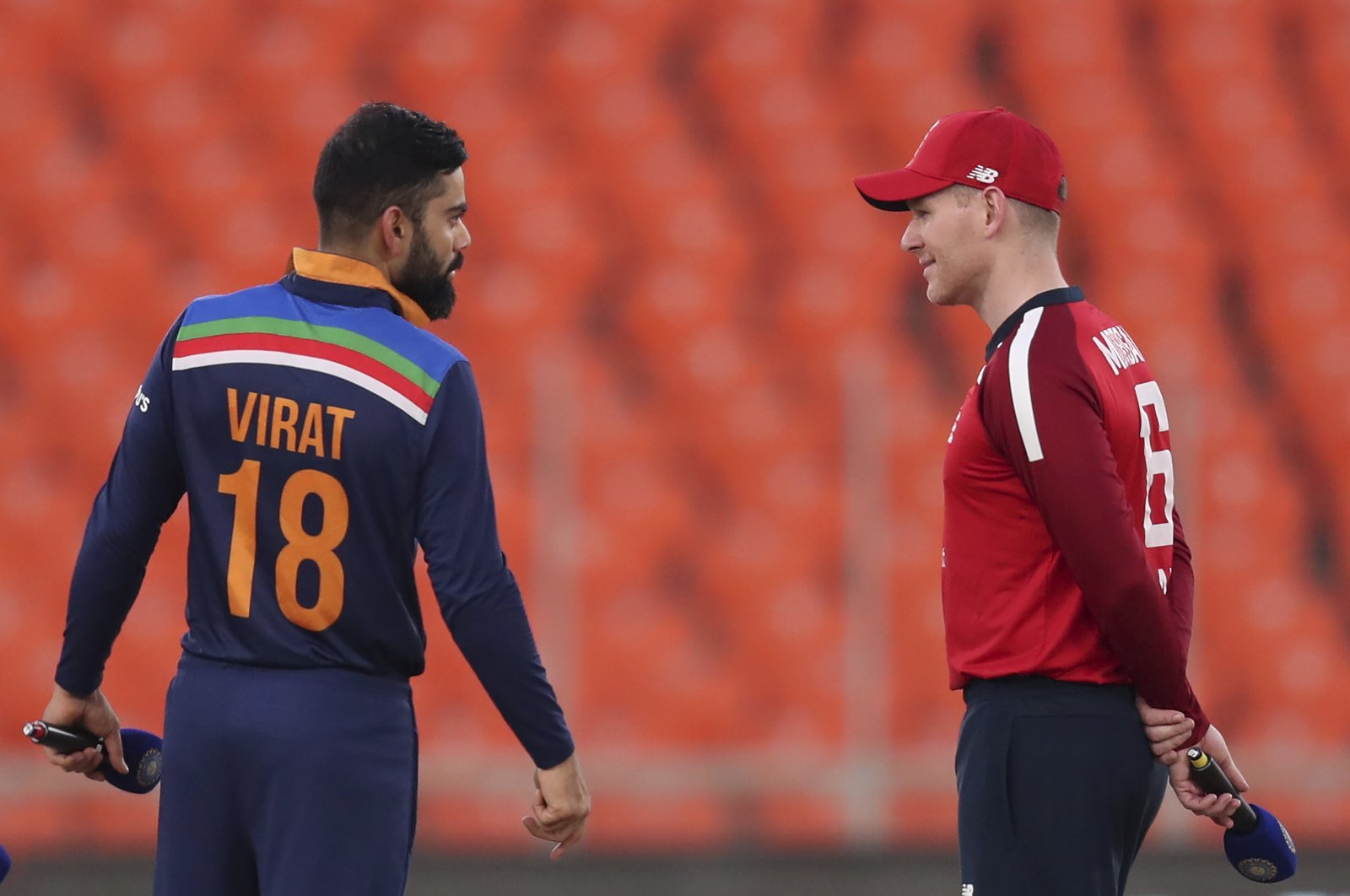 England captain Eoin Morgan (R) and India captain Virat Kohli at the toss ahead of a T20 match in Ahmedabad, India, March 20, 2021. (AP Photo)