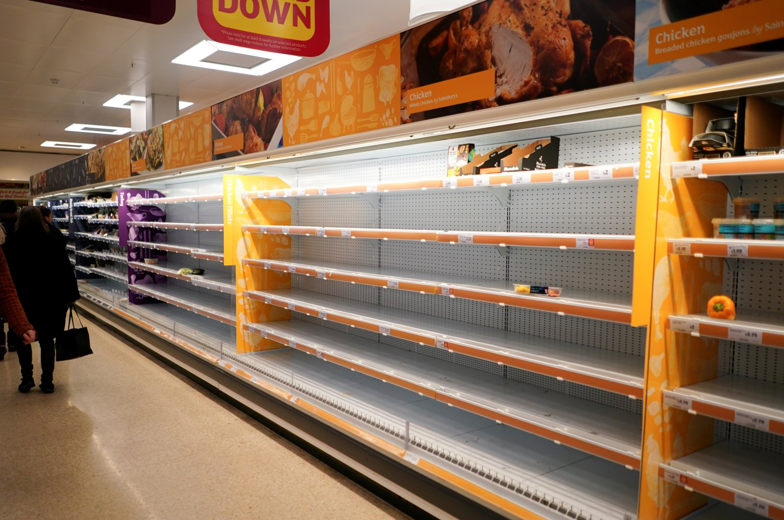 Shelves empty of fresh chicken in a supermarket in London, Britain, March 15, 2020. (Reuters Photo)