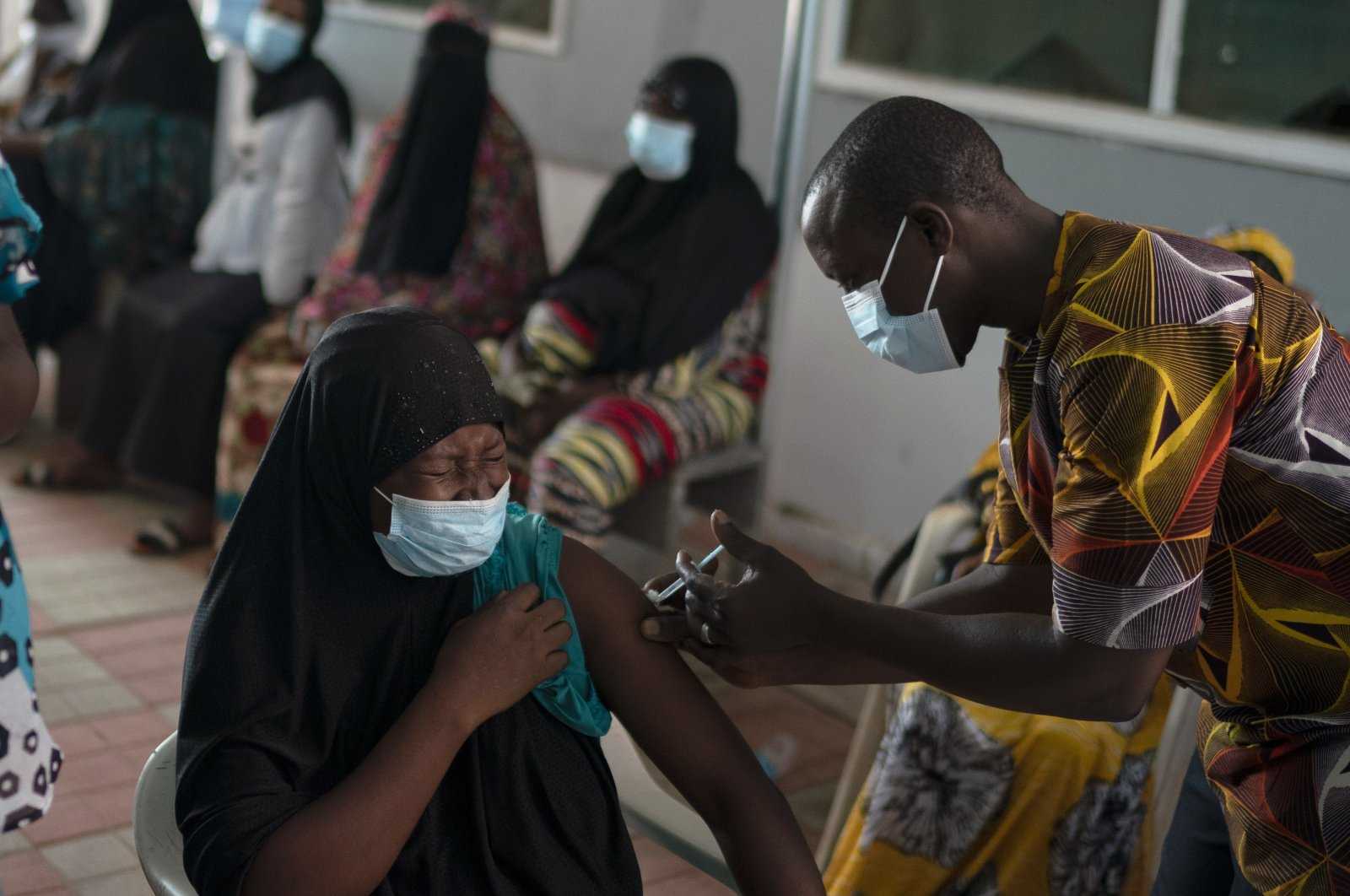 A health worker administers a dose of the Johnson & Johnson COVID-19 vaccine at the Bundung Maternal and Child Health Hospital in Serrekunda, outskirts of Banjul, Gambia, Sept. 23, 2021. (AP Photo)