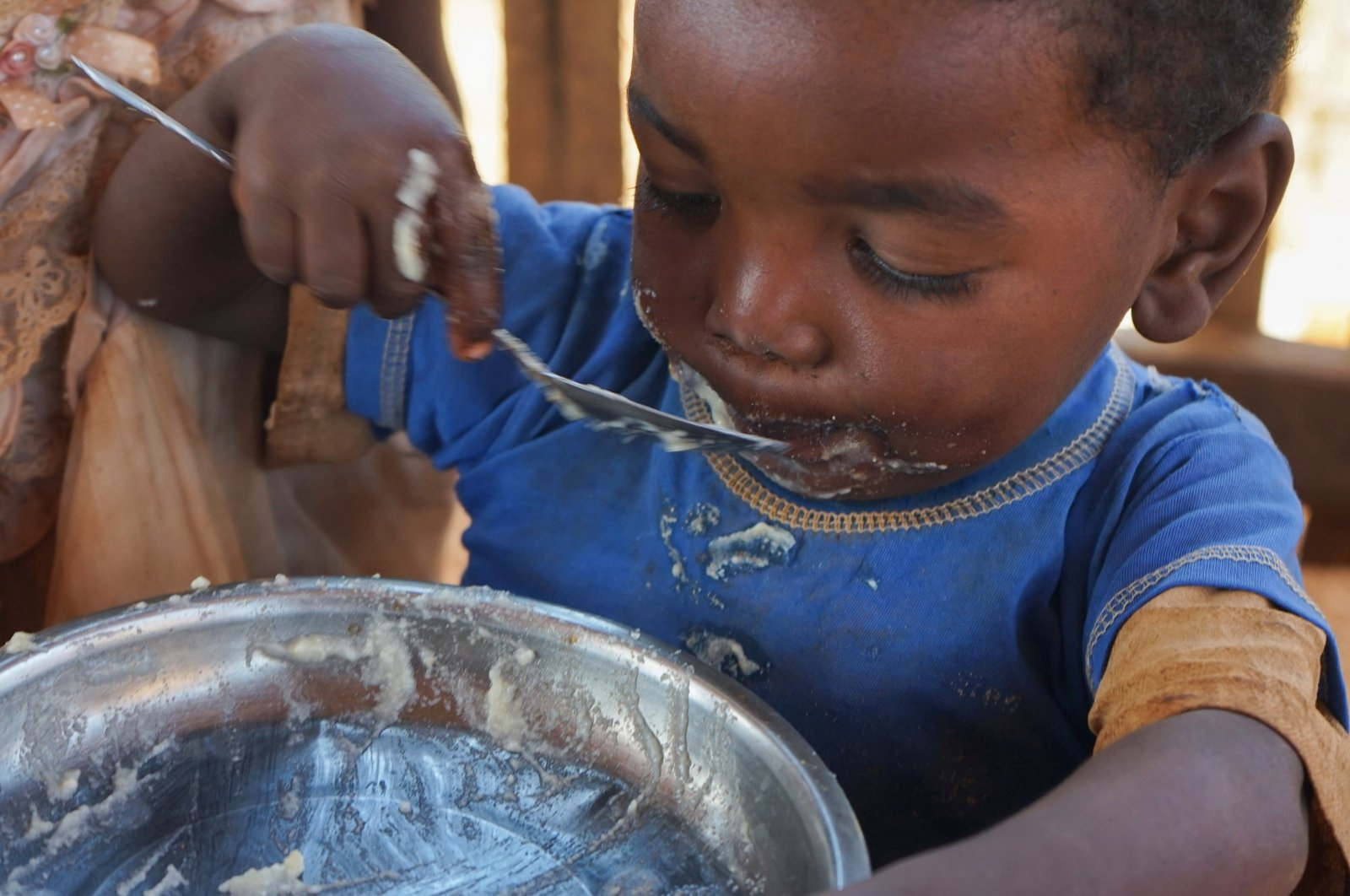 A Malagasy child eats a meal at the Avotse feeding program that benefits malnourished children with hot meals in Maropia Nord village in the region of Anosy, southern Madagascar, Sept. 30, 2021. (Reuters Photo)