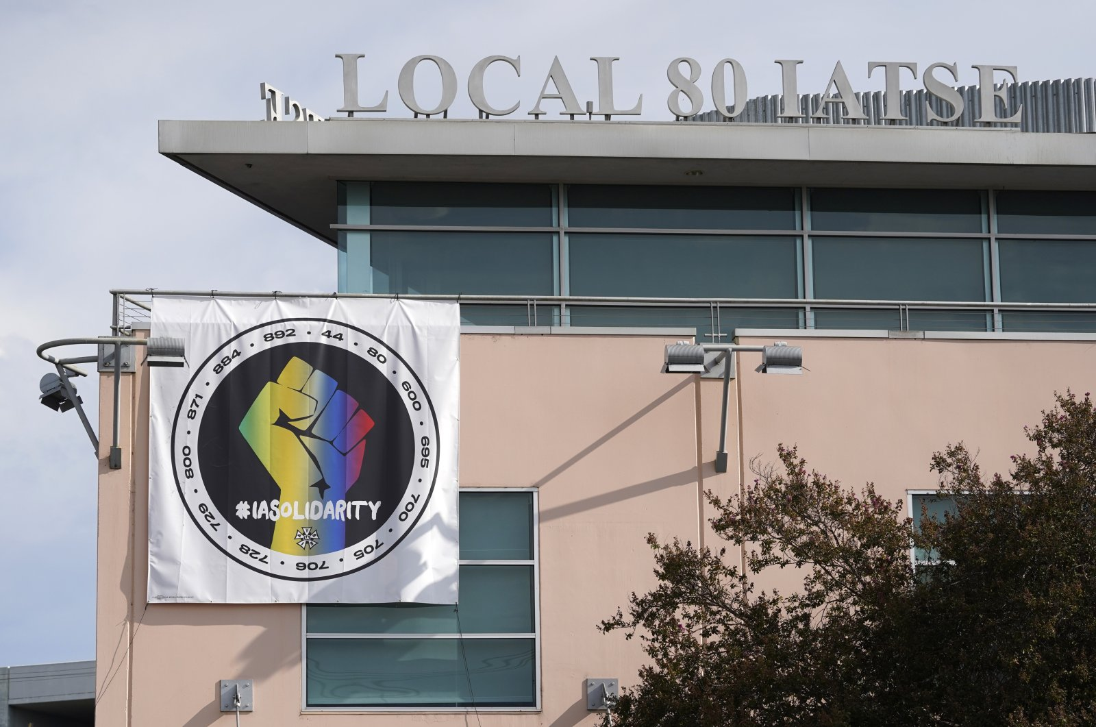 A poster advocating union solidarity hangs from the office building housing the International Alliance of Theatrical Stage Employees Local 80, in Burbank, California, U.S., Oct. 4, 2021. (AP Photo)