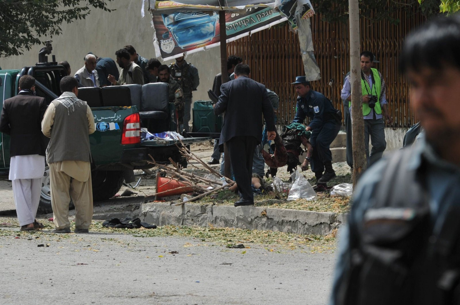 Afghan police carry the remains of a suicide attack victim in the city's diplomatic quarters, home to many Western embassies, in Kabul on Sept. 8, 2012. (AFP Photo)