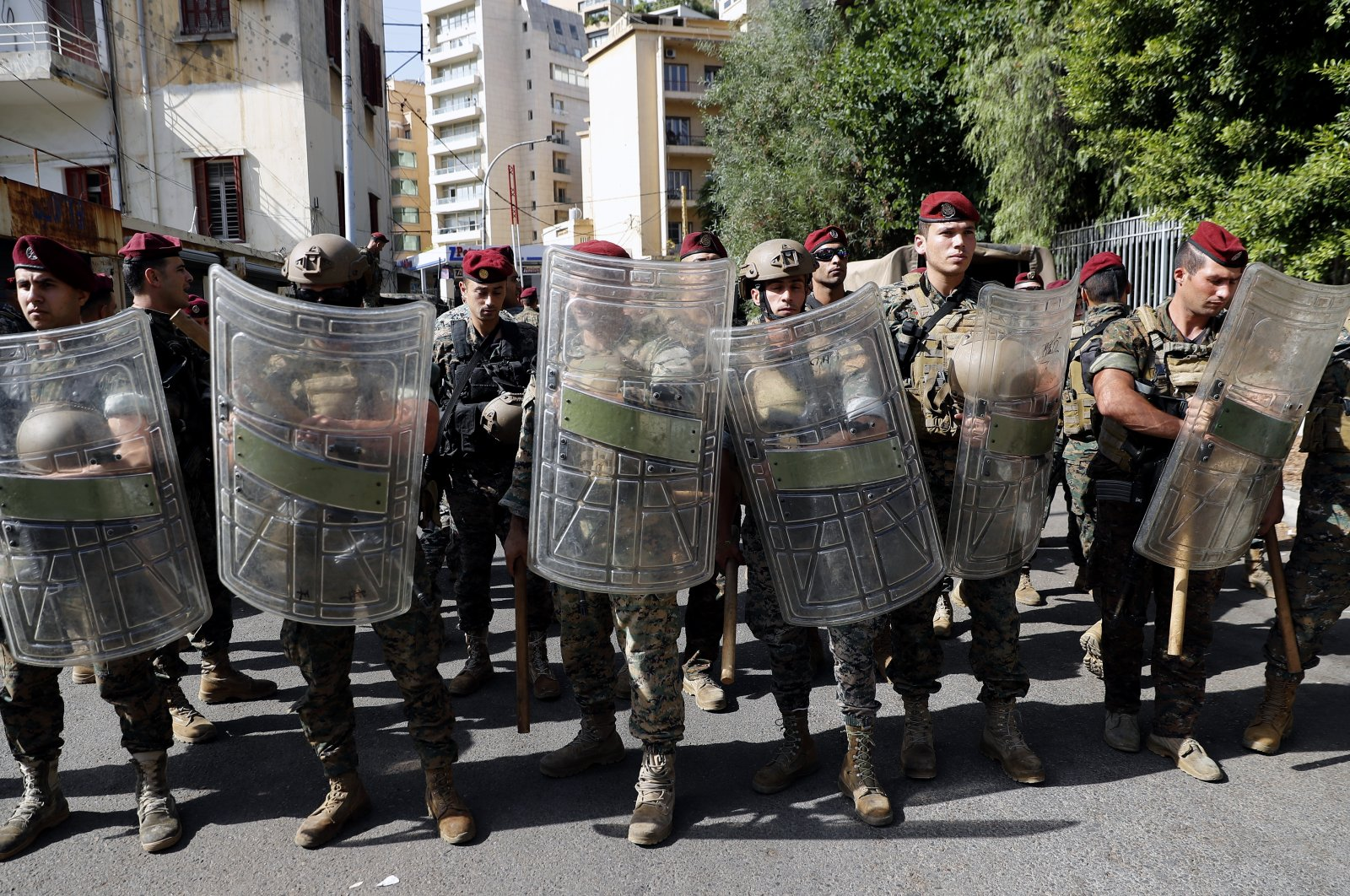 Lebanese troops stand guard near the Justice Palace as supporters of the Hezbollah and Amal groups protest against Judge Tarek Bitar who is investigating last year's deadly seaport blast, Beirut, Lebanon, Oct. 14, 2021. (AP Photo)