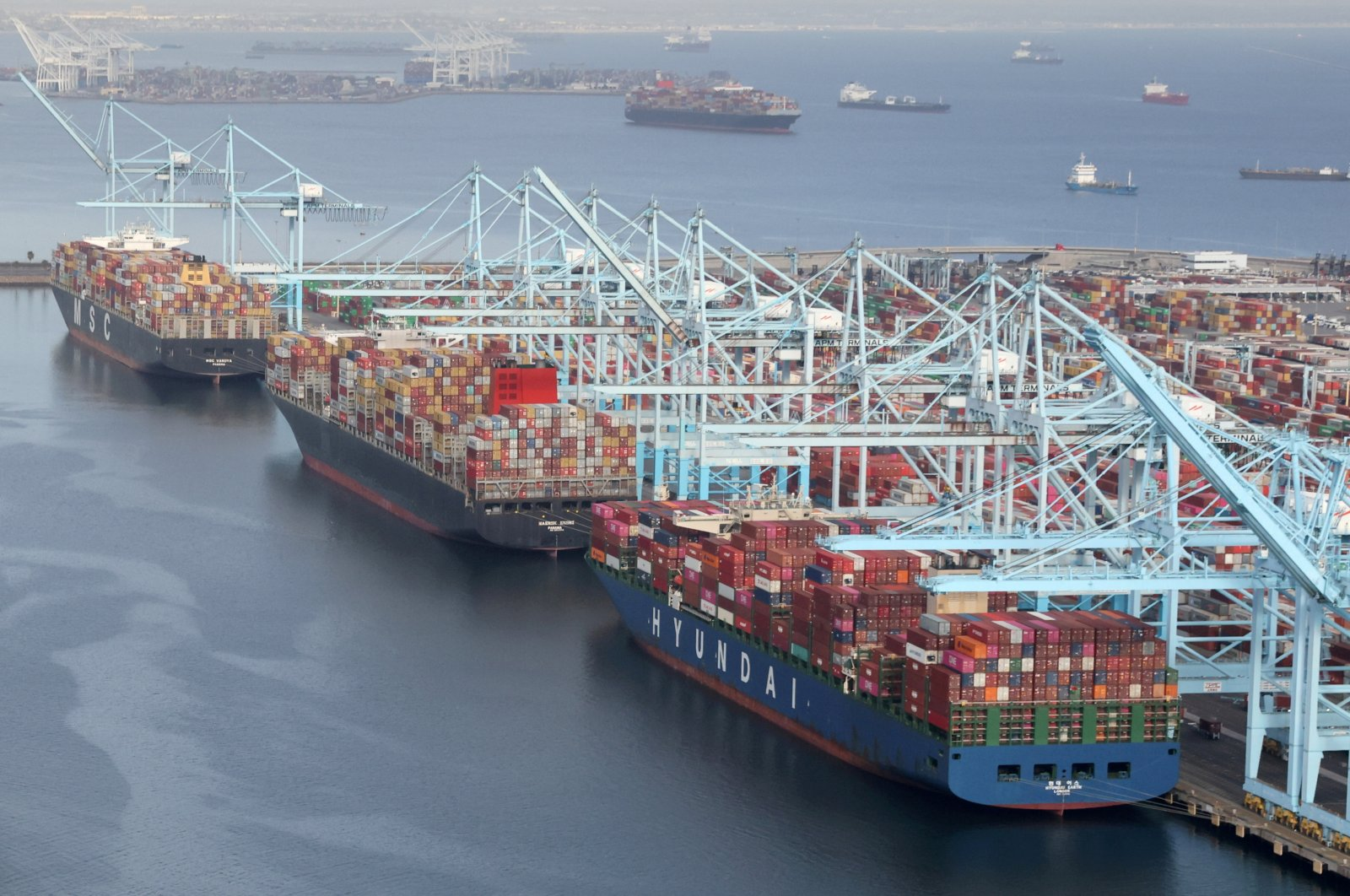 Shipping containers are unloaded from ships at a container terminal at the Port of Long Beach-Port of Los Angeles complex in Los Angeles, California, U.S., April 7, 2021. (Reuters Photo)