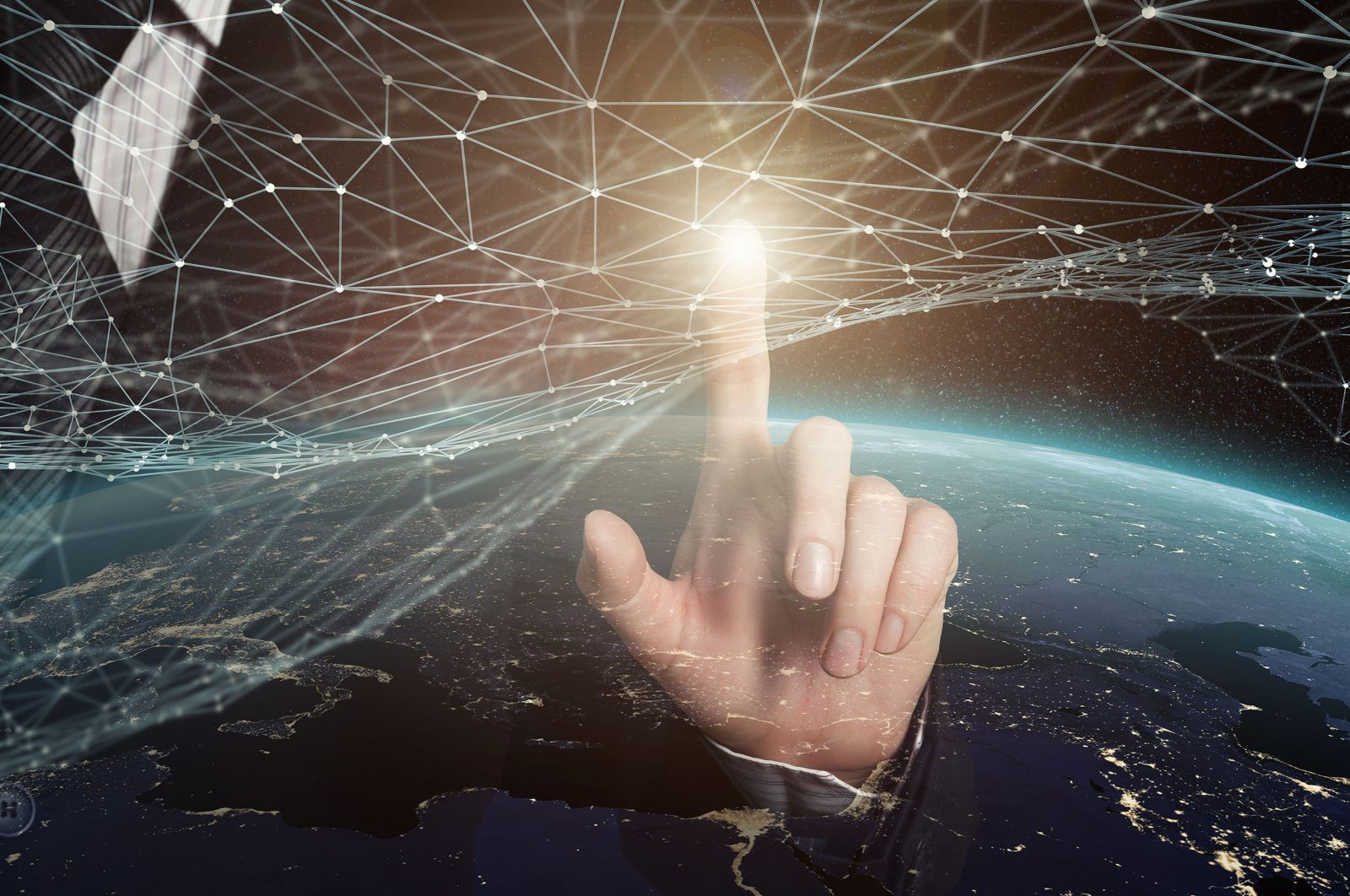 Computers, the internet, mobile phones, fiber cables and satellites weave together an ever-growing electronic, digital network where everything and everyone is interconnected today. (Shutterstock Photo)