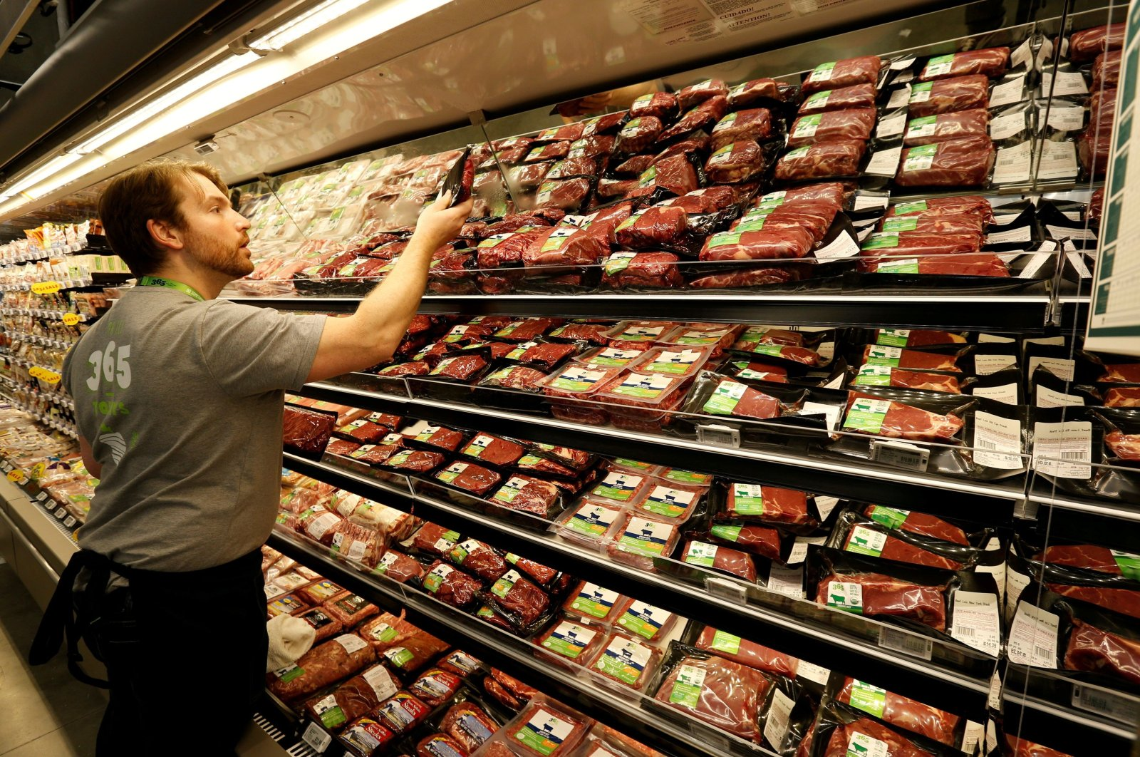 An employee checks packaged meat at a 365 by Whole Foods Market grocery store ahead of its opening day in Los Angeles, U.S., May 24, 2016. (Reuters Photo)